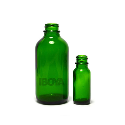 green boston round glass bottle